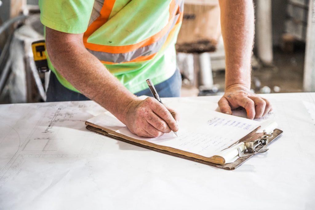 worker-filling-paperwork